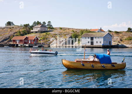 Motorboat on the way into the bay - Stock Photo