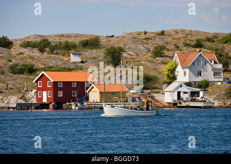 Summer house and a fishing baot in the Swedish west coast archipelago - Stock Photo