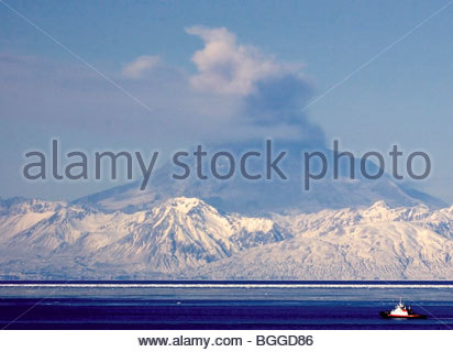 Alaska. Mt Redoubt volcano emitting steam with some ash, as viewed from Nikiski. - Stock Photo