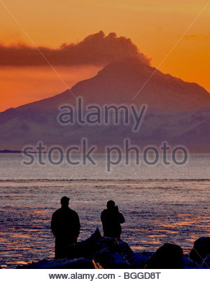 Alaska. Mt Redoubt volcano emitting steam with some ash, as viewed at sunset from Kenai visitors. - Stock Photo