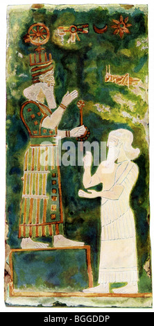 Sargon (left) pays homage to the Assyrian god Asur.  This wall painting decorated brick tile in a house in Assur. - Stock Photo