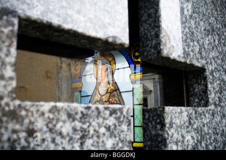 A colourful reflection of a saint on a tomb in La Recoleta Cemetery, Buenos Aires, Argentina - Stock Photo