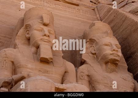 Statues of King Ramses II and Queen Nefertari at Abu Simbel, Egypt - Stock Photo