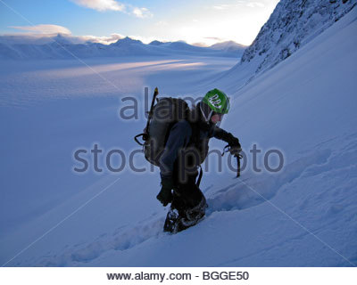 A climber ascends Peril Peak, in Chugach State Park, Alaska - Stock Photo