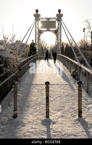 Queens Park suspension bridge in winter snow The Groves Chester - Stock Photo