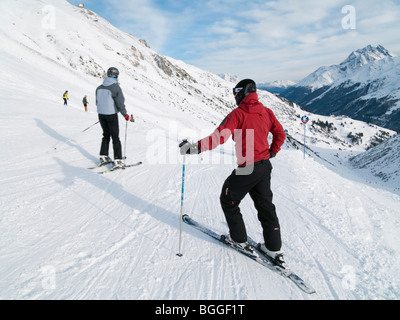St Anton am Arlberg, Tyrol, Austria, Europe. Skier in red jacket on snow covered ski slopes in the Austrian Alps. - Stock Photo