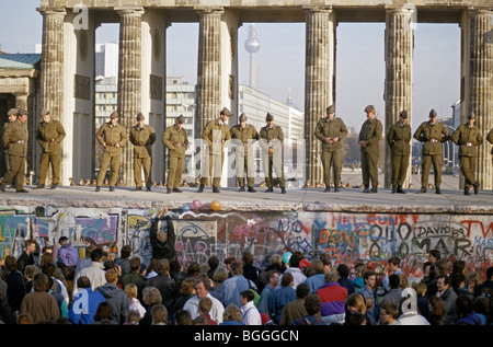 Fall of the Berlin Wall: Soldiers saving the wall at the Brandenburg Gate, Berlin, Germany - Stock Photo