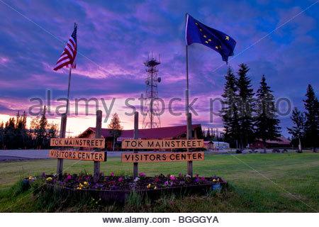 Alaska, Tok. Visitor's Center under the midnight sun. Composite. - Stock Photo
