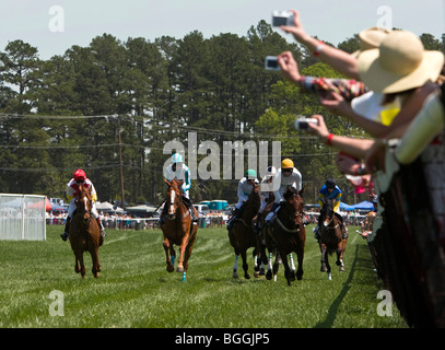 Fans take photos along the rails during the Foxfield Chase. The 2009 Foxfield Races were held at the Foxfield Race - Stock Photo