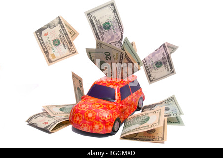 Concept image, cut-out, car, money, expense, motoring - Stock Photo