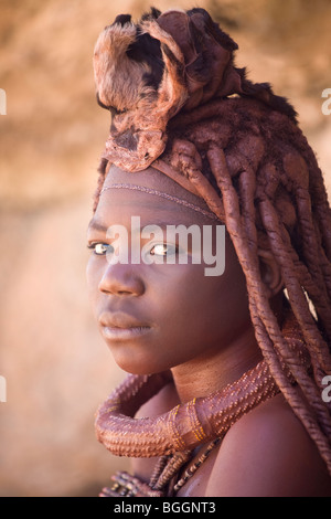 Young girl of the Himba tribe, northern Namibia - Stock Photo
