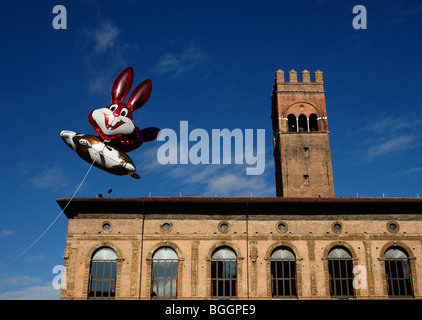 Balloons of cartoon rabbits fly in front of Palzzo re Enzo in the main square Piazza Maggiore in Bologna Emilia - Stock Photo