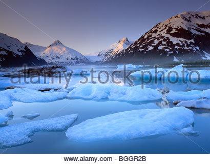 Icebergs calved from Portage Glacier in Portage Lake, at sunrise. - Stock Photo