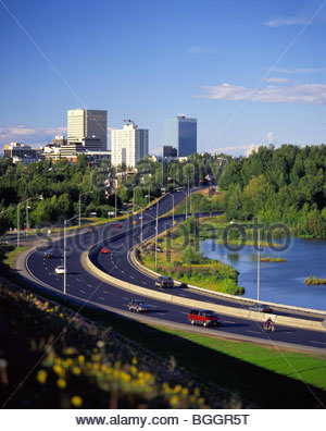 Alaska. Anchorage. View of downtown streets skirting Westchester Lagoon wetlands. - Stock Photo