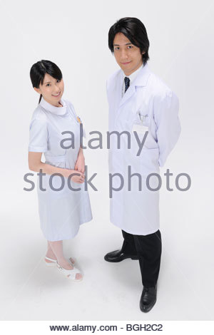 Portrait of Female Nurse and Mid Adult Doctor - Stock Photo