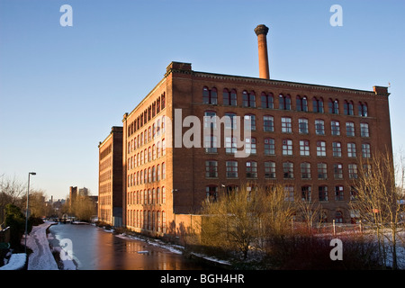 Victoria Mills (1867  + 1873) and Rochdale Canal, Miles Platting, Manchester, UK. Now residential, business and - Stock Photo