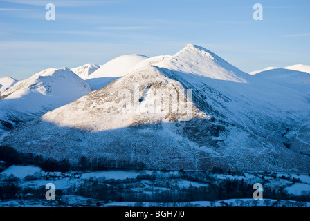Snow covered Causey Pike and the Newlands Valley in the early morning sunlight. - Stock Photo