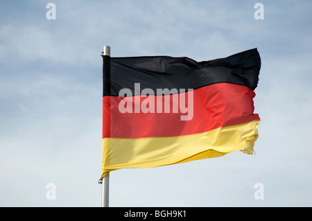 german flag germany flags tricolor deutschland deutsch pole flagpole national pride bluesky sky skies blue - Stock Photo