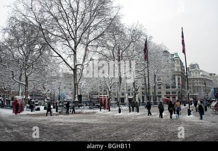 Leicester Square in Central London in the snow - Stock Photo