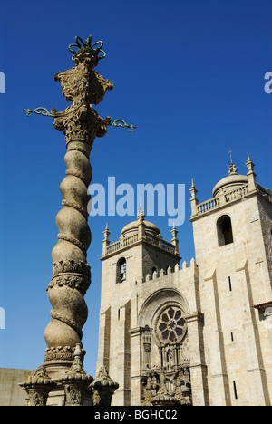 Porto. Portugal. The Sé Cathedral and ornately crafted stone pillory or pelourinho. - Stock Photo