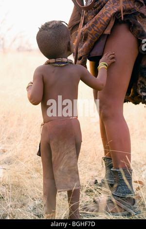 Himba child and mother, Opuwo, Namibia - Stock Photo