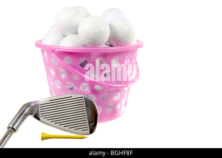 Bucket with golf balls and iron on white - Stock Photo