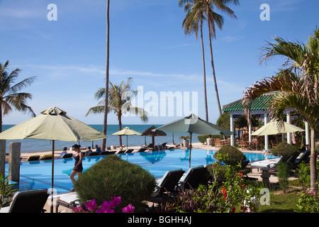 Swimming pool and beach and sea Mui Ne Vietnam - Stock Photo