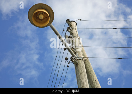 Combined electricity supply pole and lamp post. - Stock Photo