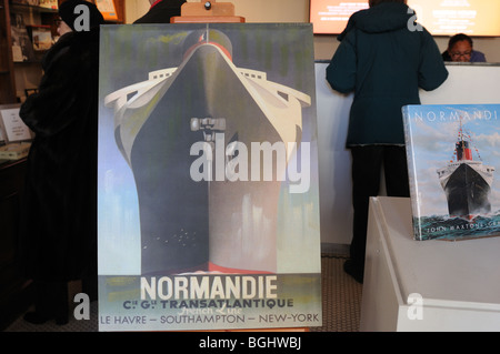 A poster and a book advertise an exhibit about the ocean liner, SS Normandie, at the South Street Seaport Museum. - Stock Photo