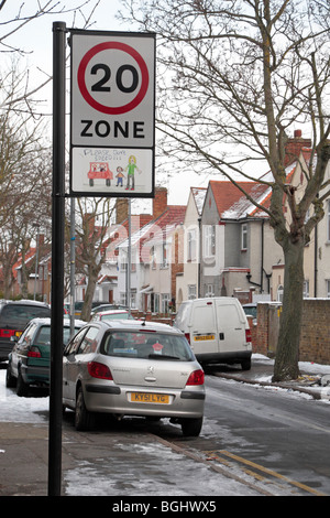 A 20mph Zone road sign in Hounslow, Middx, UK with a children's drawing to emphasis dangers of driving too quickly. - Stock Photo