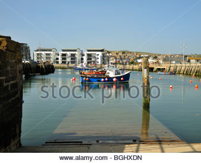 Fishing Boat in Harbour at West Bay, Bridport, Dorset - Stock Photo