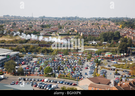 Aerial veiw over Grantham Asda supermarket, with the 'Tornado' steam train in the background. - Stock Photo