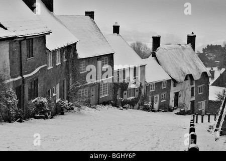 Winter on Gold Hill at Shaftesbury in Dorset depicting the famous row of traditional cottages situated on the cobbled - Stock Photo