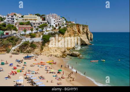 Portugal, Algarve, Praia do Carvoeiro, the village and beach in summer - Stock Photo