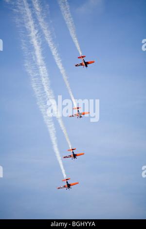 Blades aerobatic display team flying Extra 300 LP aircraft at RAF Leuchars Airshow 2009, Fife, Scotland - Stock Photo