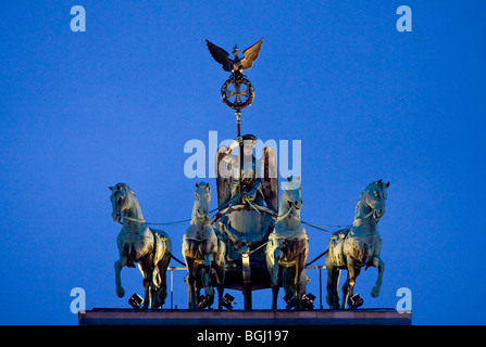 Brandenburg gate with Quadriga on top of in Berlin at sunset Stock ...