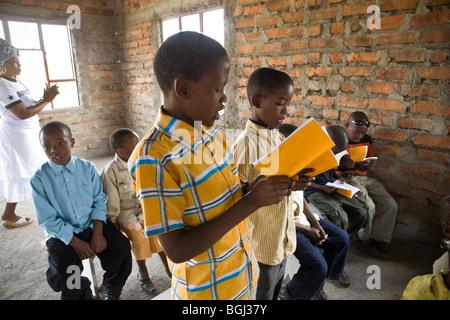 Children at a church service, Kilimanjaro Region, Tanzania, East Africa. - Stock Photo