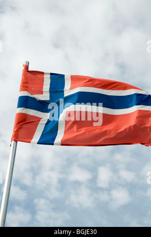 Norwegian Norway norge  flag flags pole national identity flutter fluttering in the breeze wind flagpole countryNorwegian - Stock Photo