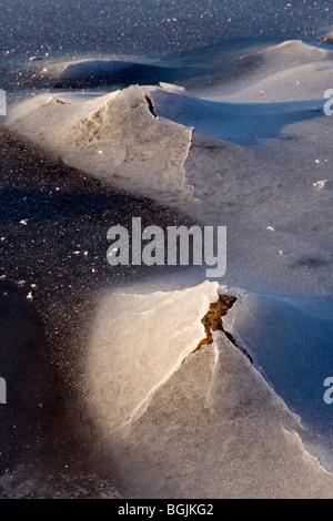 Ice covered rocks in closeup at Baltic Sea wintery coastline at Ezurgu cliffs in Vidzeme Latvia - Stock Photo