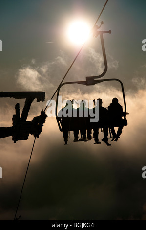 View of Skiers at the chair lift in Cerna Hora Ski Resort, Karkonosze, Czech Republic. - Stock Photo