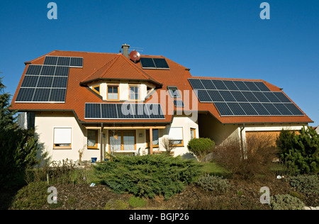 New house with solar panels on roof in Franconia, Northern Bavaria, Germany - Stock Photo