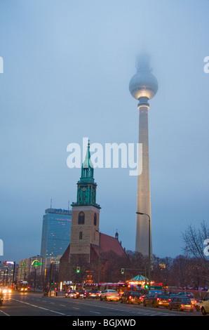 Tv Tower on Alexander Square, Berlin ( Fernsehturm am Alexanderplatz, Berlin ) and St Mary's church  (Sankt St. - Stock Photo