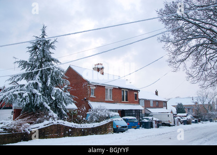 domestic house and snow covered telephone lines on urban street. Major snow fall A3 area of hampshire january 2010 - Stock Photo