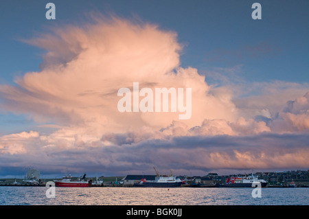 Cumulus cloud build up over Kirkwall Harbour Orkney Scotland - Stock Photo