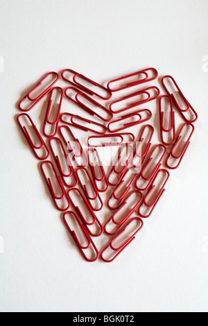 office romance concept - heart of red paper clips, paperclips, isolated on white background - Stock Photo