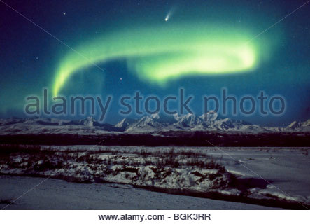 Alaska, Big Delta. The comet Hale-Bopp shines brightly through northern lights over the Delta River. - Stock Photo