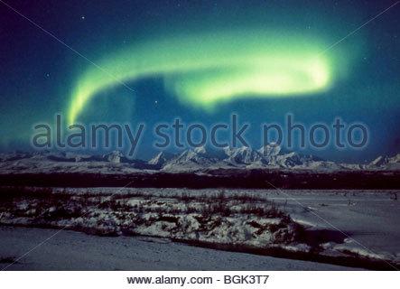 Alaska, Big Delta. The comet Hale-Bopp shines brightly through northern lights over the Delta River. - Stock Photo