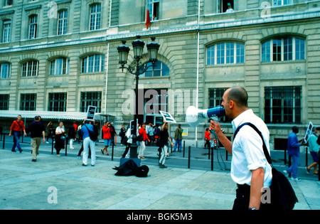 Paris, France - AIDS Activists of Act Up Paris Protesting Against Expulsion of Sans Papiers, Migrants, Police Headquarters - Stock Photo