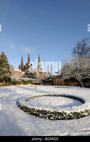 Three spires Cathedral seen from War Memorial Garden of Remembrance on snowy winter's day 2010 Lichfield Staffordshire - Stock Photo