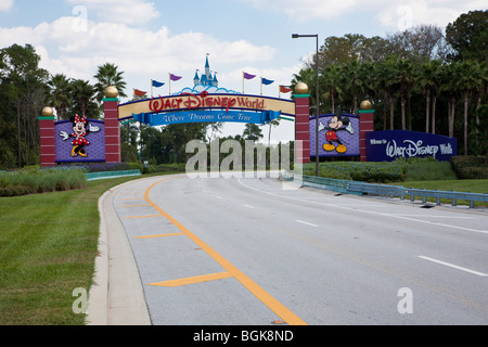 Western entrance to Walt Disney World property in Central Florida shows Cinderella's castle - Stock Photo